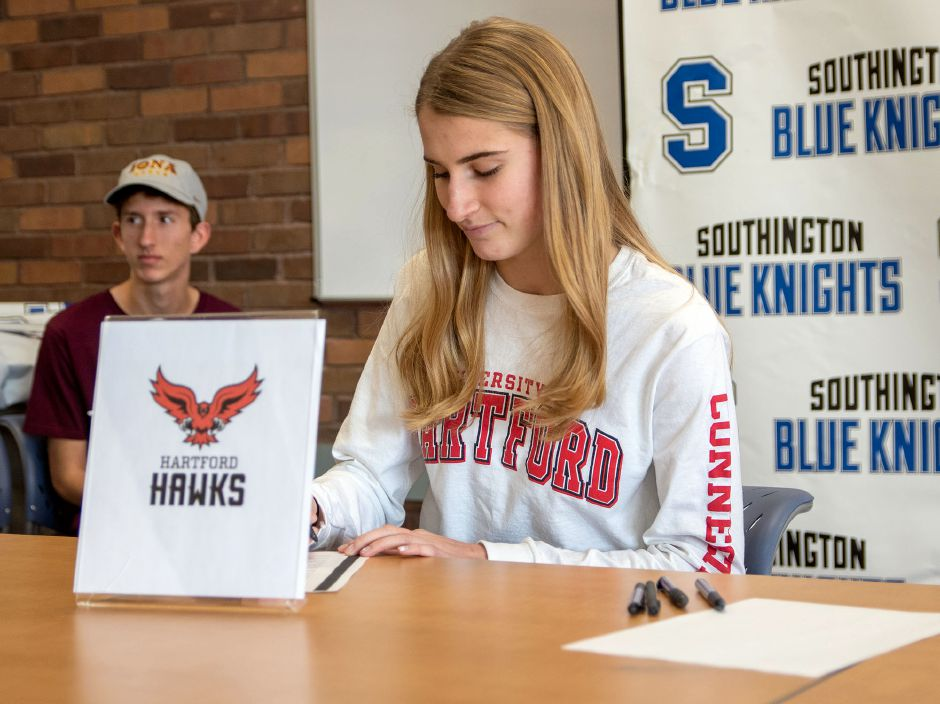 Southington High School's Sydney Garrison signs a letter of intent to the University of Hartford during a signing ceremony at the Southington Library on Wednesday, Nov. 13, 2019. Aaron Flaum, Record-Journal
