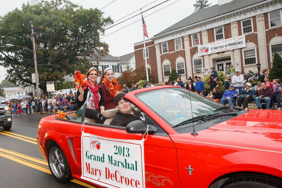 Southington Apple Harvest Festival Grand Marshal Mary DeCroce left rides in a convertible on Main Street during the parade in Southington Sunday October,6 2013 | (Justin Weekes / For the Record-Journal)