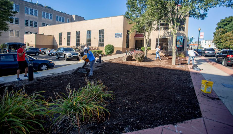 A group from the Record-Journal spreads mulch in front of the Meriden Y on East Main Street as part of the United Way Day of Caring Sept. 17, 2019. | Richie Rathsack, Record-Journal