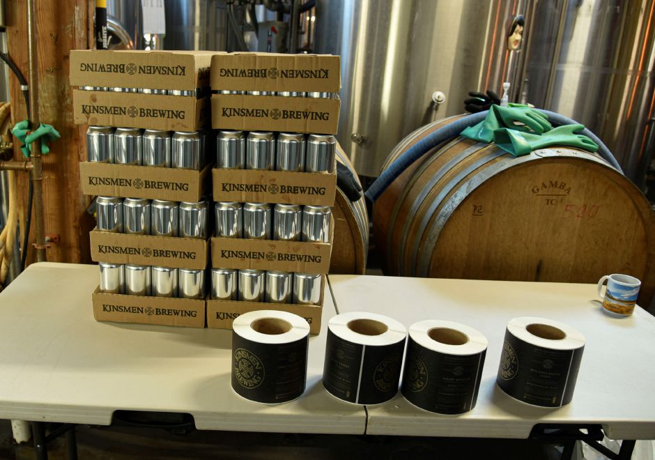 Empty cans and fresh labels wait to be filled and adhered to a new batch of beer at Kinsmen Brewing Co. in Southington on Jan. 15, 2020. | Bailey Wright, Record-Journal
