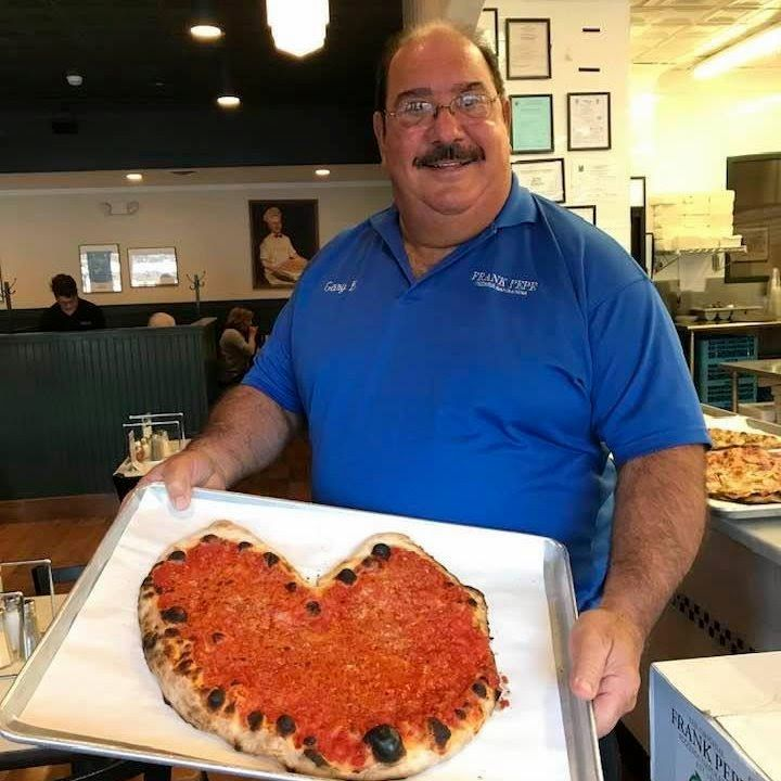 Pepe's Pizza co-owner Gary Bimonte, who died at home in Wallingford Wednesday night, is seen here in a photo the restaurant posted to Twitter on Thursday.