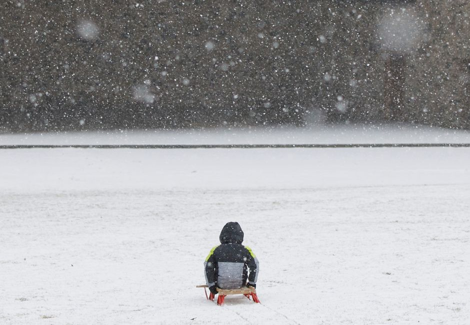 Matthew Gallosa, 3, of Plainville, sleds toward the band shell on his Flexible Flyer sled as light snow falls at Hubbard Park in Meriden, Tues., Jan. 26, 2021. Snow will continue into tonight bringing two to four inches of accumulation. Dave Zajac, Record-Journal
