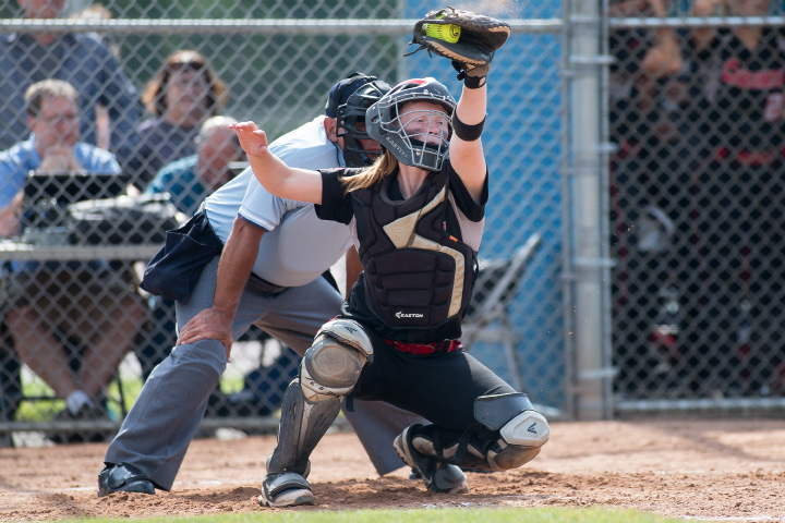 Cheshire catcher Megan Hodgdon reaches for a high pitch from Abby Abramson during Saturday'sgame.