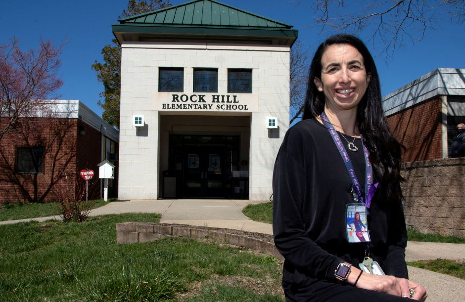 Emily Banach poses for a photo on Tuesday in front of Rock Hill Elementary School in Wallingford where she has been the school's social worker since 2012. On July 1, 2021, Banach will become the new principal at Highland Elementary School in Wallingford.