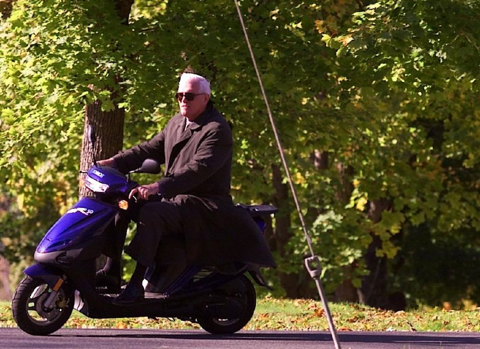 Mayor Joe Marinan rolls down Lambert Street on his daughters motor scooter Monday afternoon Oct. 25, 1999. He originally bought the scooter for his daughter.