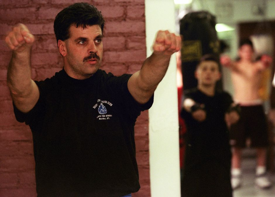 Larry Pelletier leads the young men in callisthenics at the Beat the Street Silver City Boxing Club, October 1999