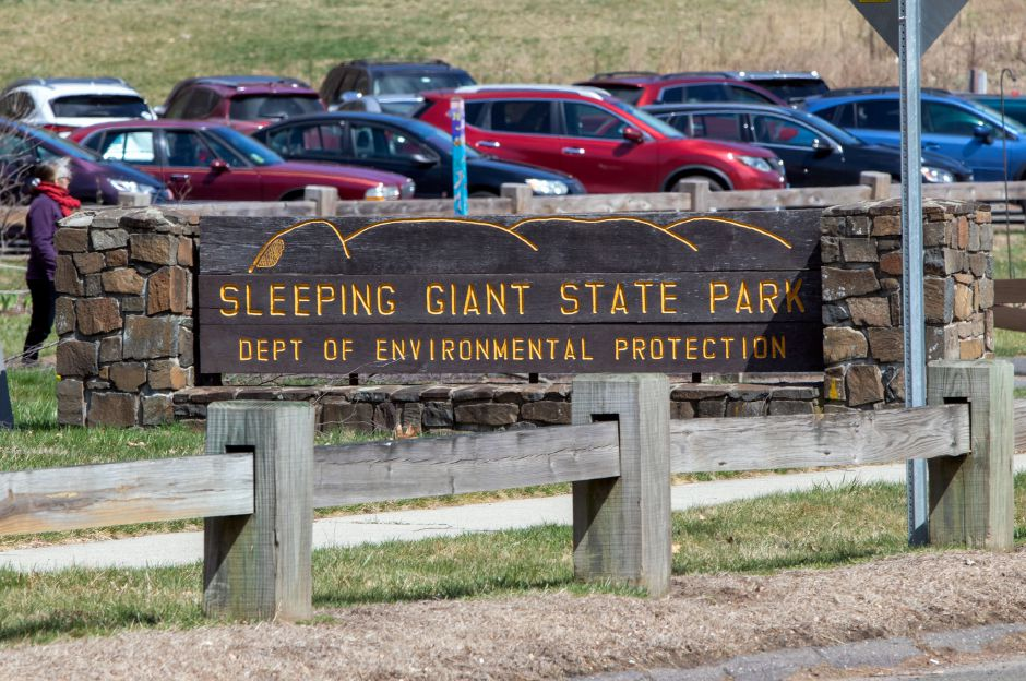 At right, Cars fill one of the parking lots at Sleeping Giant State Park.