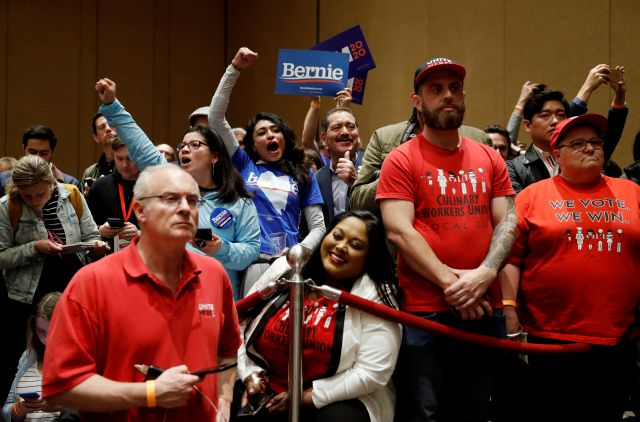 Supporters of Democratic presidential candidate Sen. Bernie Sanders, I-Vt., cheer as members of the Culinary Workers Union watch during a Democratic presidential caucus at the Bellagio hotel-casino, Saturday, Feb. 22, 2020, in Las Vegas. (AP Photo/John Locher)