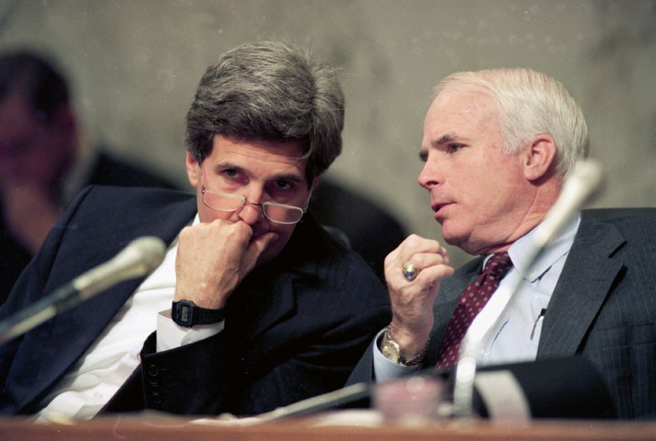 ** FILE ** In this Dec. 1, 1992 file photo, Sen. John Kerry, D-Mass., left, chairman of the Senate Select Committee on POW/MIA Affairs, listens to Sen. John McCain, R-Ariz., a former POW in Vietnam, during a hearing of the committee on Capitol Hill in Washington. The committee released classified testimony detailing the Pentagon