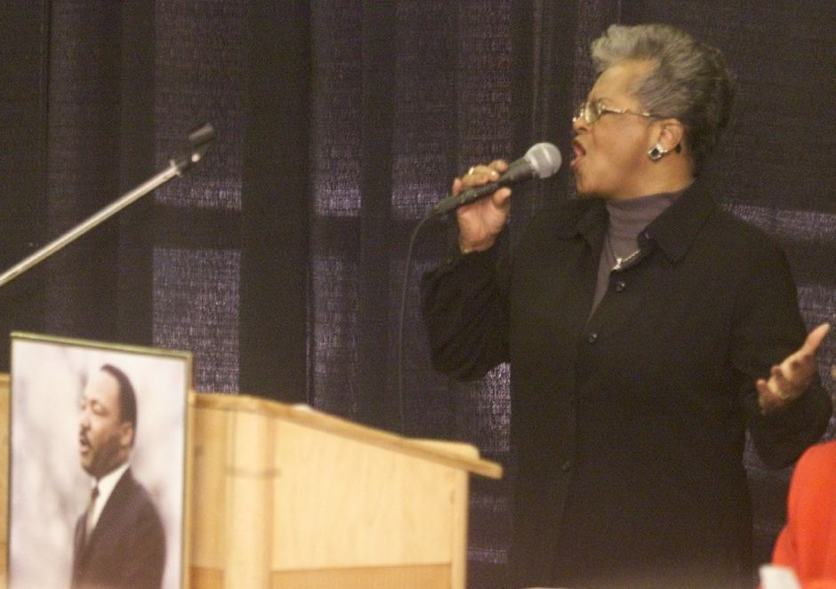 Valerie Collins sings the Invocation at the start of the 16th Annual Albert Owens-Martin Luther King, Jr. Mon., Jan. 15, 2001 at Maloney.