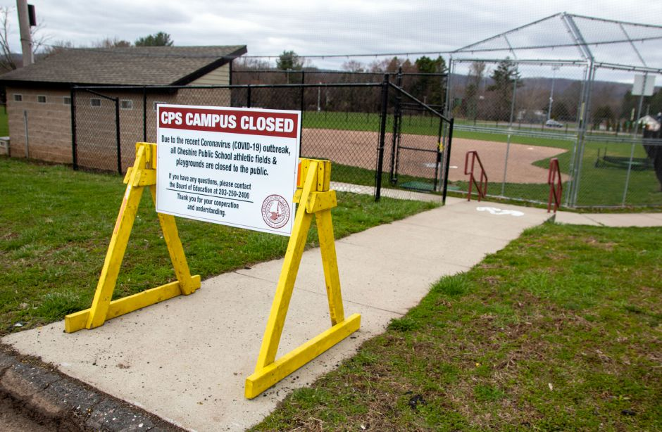 A sign by the Cheshire High School softball field advises that all athletic fields and playgrounds at Cheshire public schools are closed due to the COVID-19 outbreak. Aaron Flaum, Record-Journal