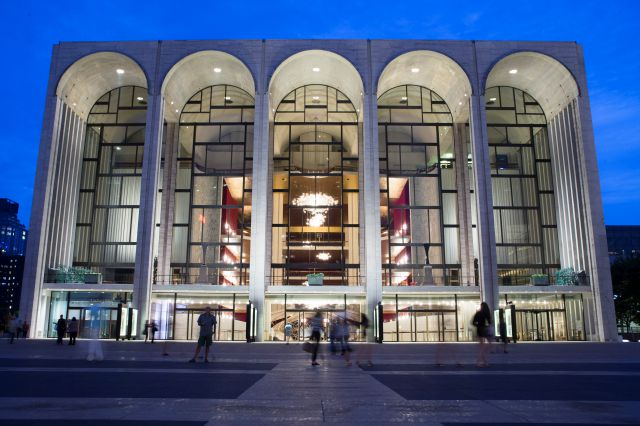 FILE - In this Aug. 1, 2014, file photo, pedestrians make their way in front of the Metropolitan Opera house at New York