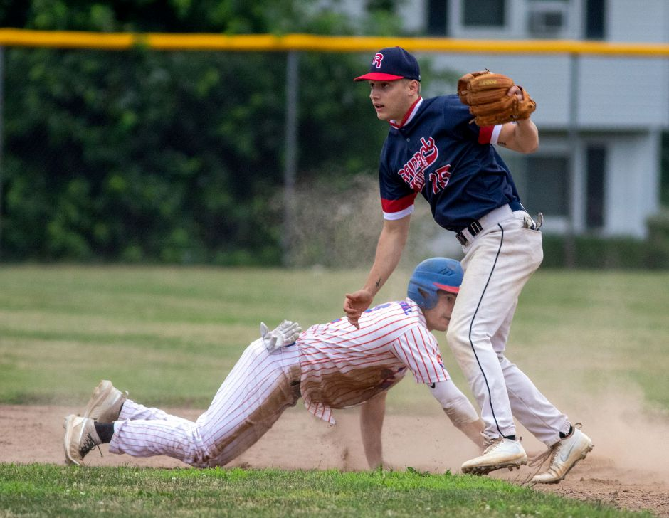 Joe Gulino, left,  gets back to second base before Rainbow Graphics infielder  Marcus Fry could make the tag.Aaron Flaum, Record-Journal