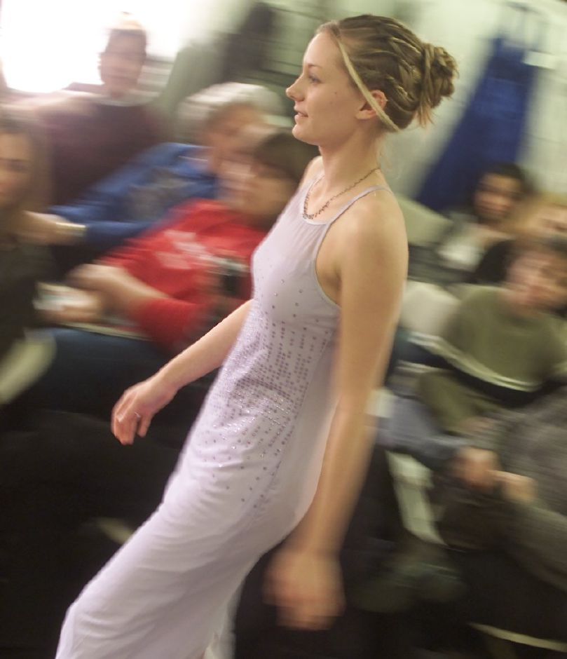 Alyssa Roberts-Peteria, a sophamore at Sheehan High School in Wallingford, makes her way down the catwalk wearing a one piece dress by Stephen of New York. Area high school girls modeled prom dresses at ala Boutique in Wallingford Saturday afternoon Jan 27, 2001.