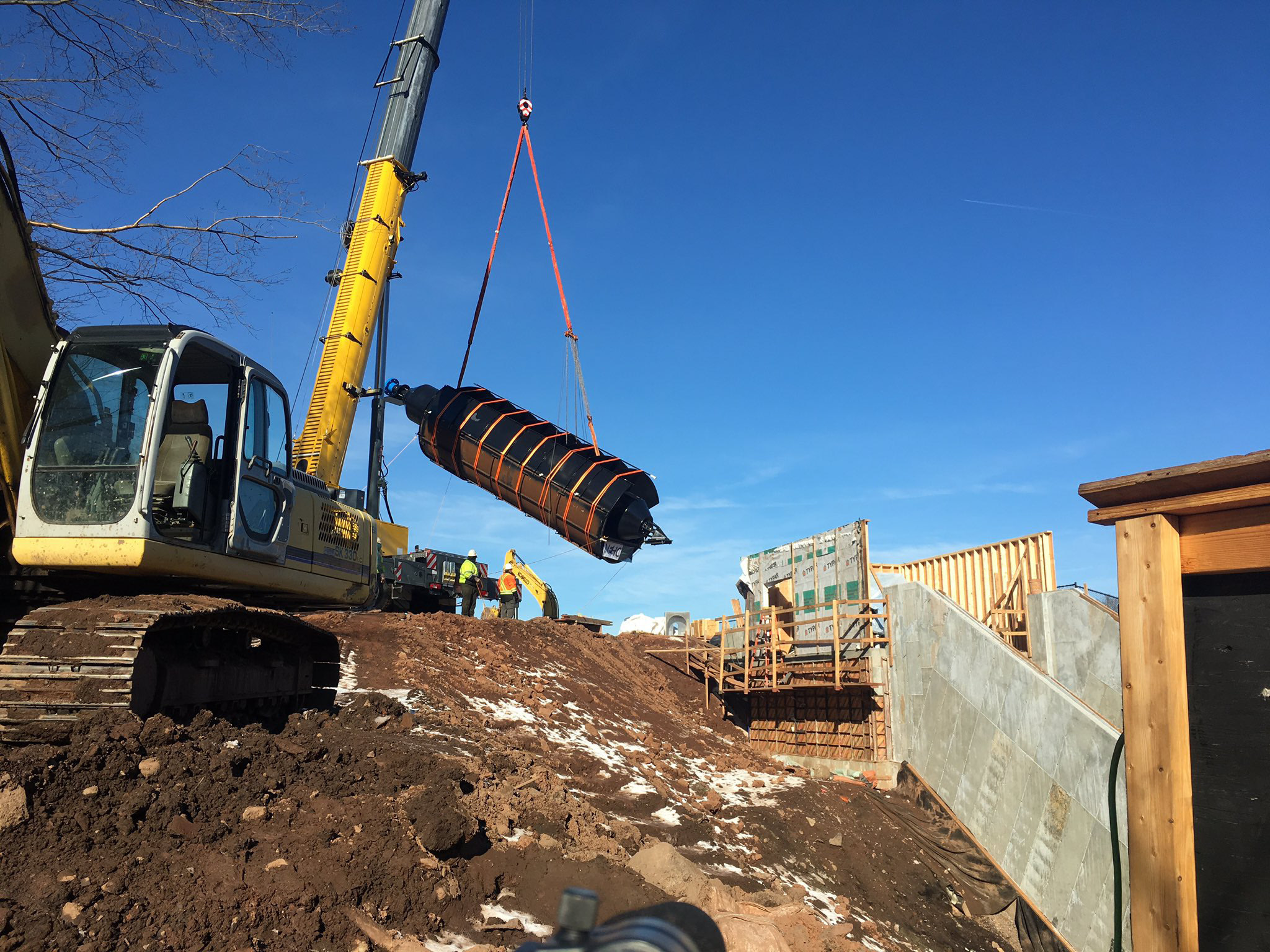 Crews installed the 20-ton, 35-foot-long Archimedes screw at Hanover Dam on Tuesday, Dec. 20. | Leigh Tauss, Record-Journal