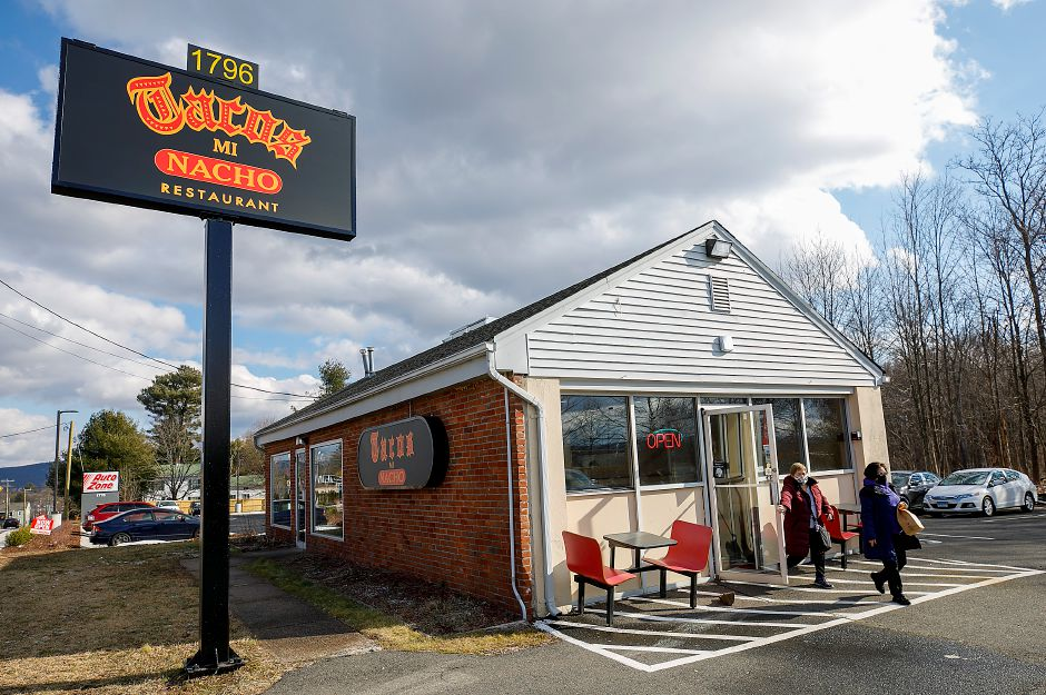 Customers pick up orders on Wednesday at the new Tacos Mi Nacho  at 1796 Meriden-Waterbury Turnpike in Southington. Tacos Mi Nacho