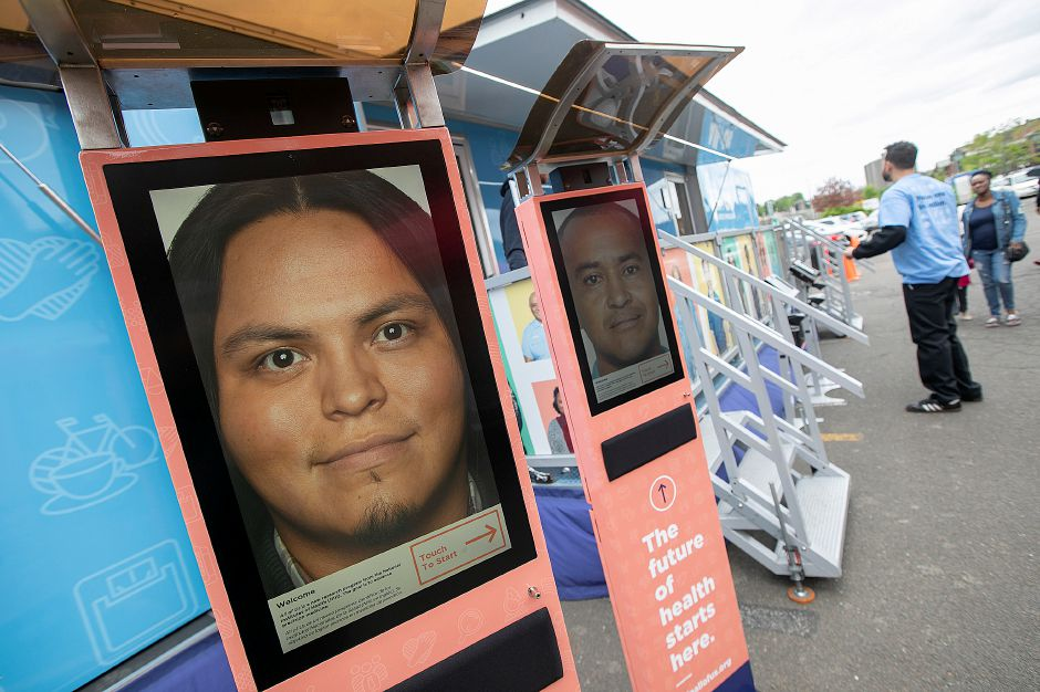 Electronic kiosks in front of the All of Us Mobile Education and Enrollment Center at the Community Health Center on State Street in Meriden, Mon., May 13, 2019. All of Us visits communities nationwide to raise awareness about the All of Us research program. Dave Zajac, Record-Journal