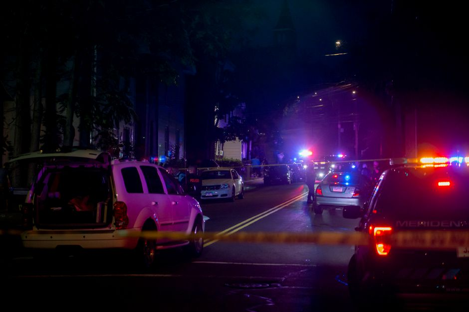 Detectives process the scene on Olive Street after a shooting in Meriden Aug. 19, 2020. | Richie Rathsack, Record-Journal