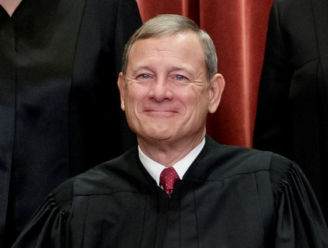 FILE - This Nov. 30, 2018, file photo shows Chief Justice of the United States, John G. Roberts, as he sits with fellow Supreme Court justices for a group portrait at the Supreme Court Building in Washington. Roberts will move from the camera-free, relative anonymity of the Supreme Court to the glare of television lights in the Senate to preside over President Donald Trump
