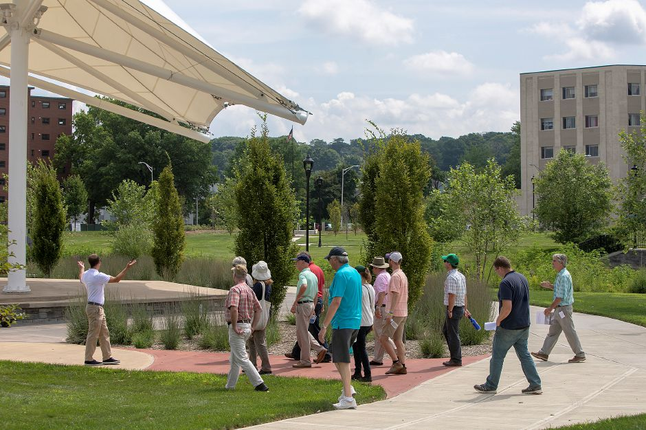 Milone & MacBroom Lead Landscape Architect Ryan Chmielewski, left, leads members of the American Society of Landscape Architects on a tour of the Meriden Green, Wednesday, August 8, 2018. Dave Zajac, Record-Journal