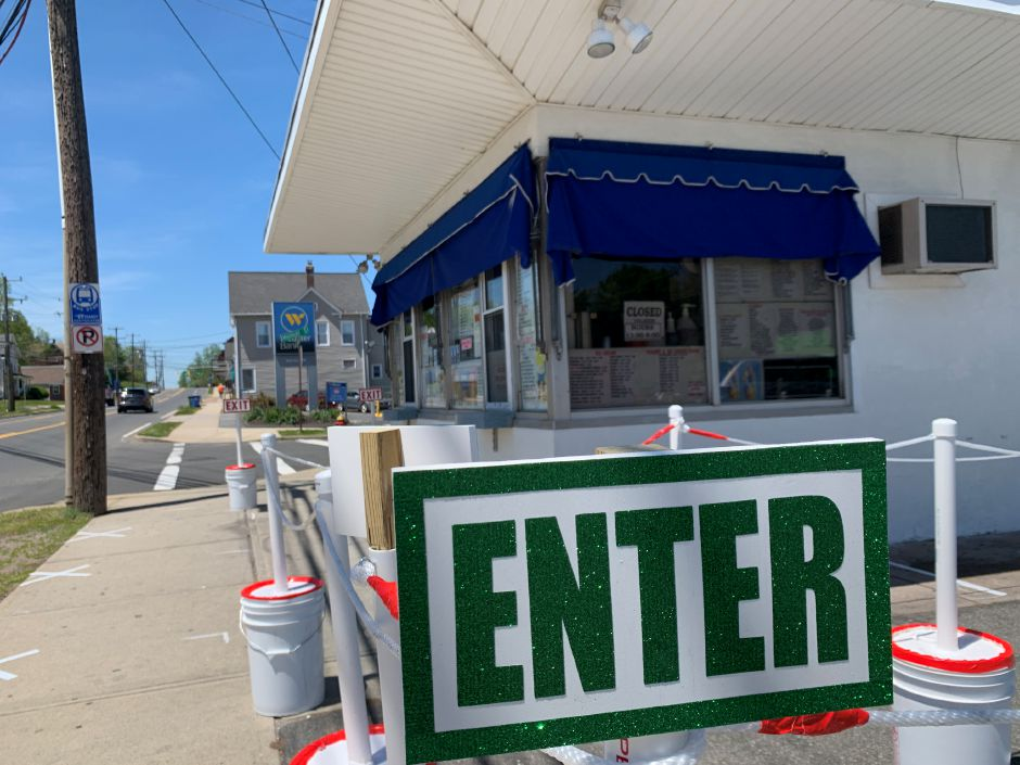 A sign shows where to enter the new wait line seen here on Wednesday  before the reopening of Les' Dairy Bar on East Main Street in Meriden. The ice cream shop's owner Debra DiGiandomenico said she is aiming to reopen today.Photos by Bailey Wright, Record-Journal