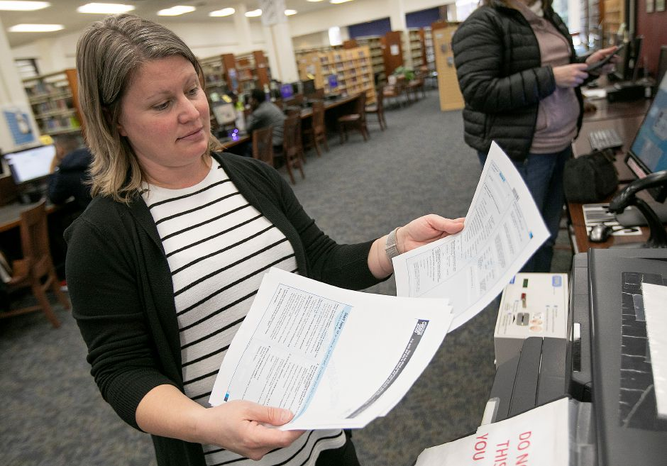 Librarian Laura Pudvah prints out sample copies of 2020 Census forms at the Meriden Public Library, Wed., Feb. 12, 2020. Dave Zajac, Record-Journal