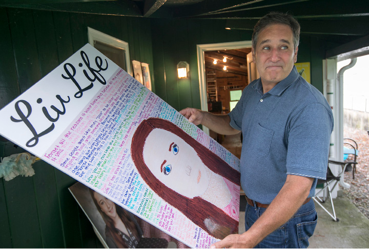 "John Fusco, of Southington, holds artwork by his daughter Olivia at his residence, Friday, August 4, 2017. Olivia Fusco, 14, and her friend AnnMarie ""Annie"" Olender, 16, died in a tragic car accident on I-84 in 2015.  
