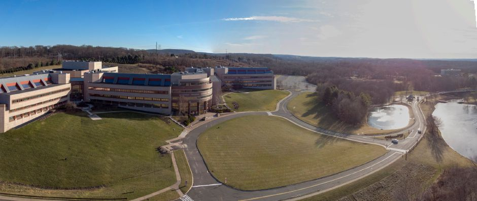 A composite image showing the former Bristol-Myers Squibb building on Research Parkway in Wallingford, Jan. 11, 2019. The Research Parkway entrance to the facility is on the right. | Richie Rathsack, Record-Journal