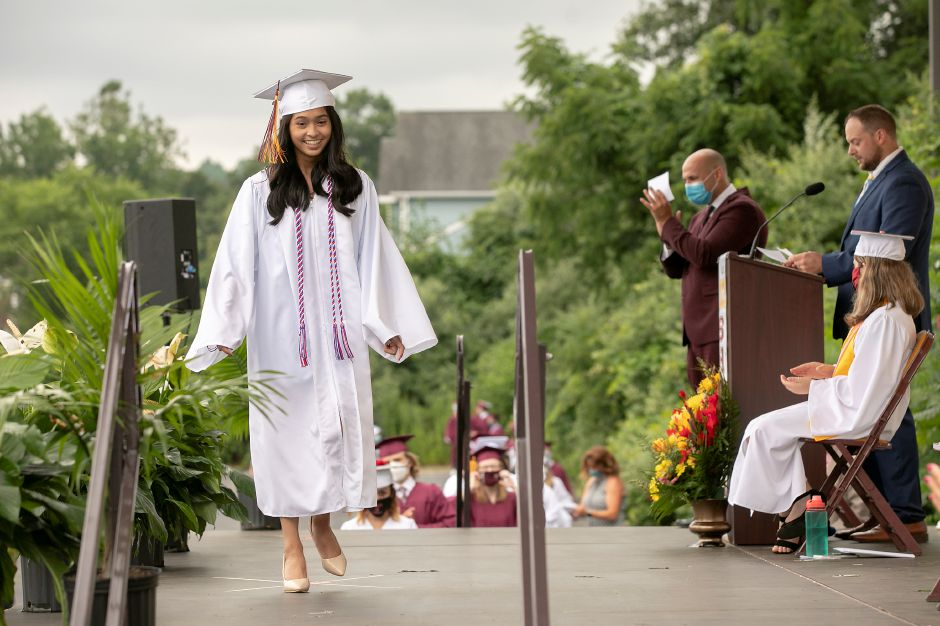 Graduate Ivanna Roque smiles after her name is called to receive her diploma during graduation ceremonies at the Toyota Oakdale Theatre in Wallingford, Mon., Jul. 6, 2020. Dave Zajac, Record-Journal