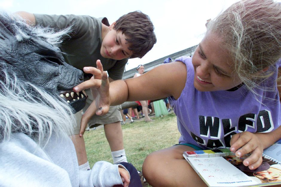 "Wearing a werewolf mask, Jay Telesco, 9, 0f Wallingford gets his ""teeth"" touched up with paint by camp counselor Andrea Porter (right) ,17 of Wallingford during Doolittle Park Summer Camp"