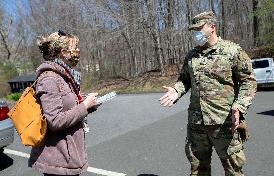 Reporter Lauren Takores interviews First Lieutenant Andrew Solari at Quinnipiac Valley Center in Wallingford, Wed., Apr. 15, 2020. Connecticut National Guard reserve soldiers are setting up more than 30 beds for recovering COVID-19 patients at the center which is sixth on the state