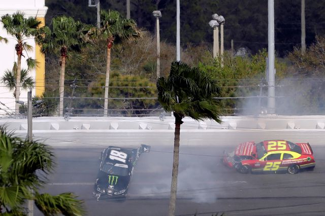 Riley Herbst (18) and Chris Cockrum (25) crash during the NASCAR Xfinity series auto race Saturday, Feb. 15, 2020, at Daytona International Speedway in Daytona Beach, Fla. (AP Photo/Chris O