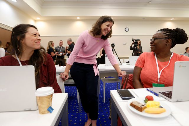 Rep. Elaine Luria, D-2nd Va., center, greets Monique Rico-Chavez, left, and Ayodeloe Lewis, right, as they participate in a USO Pathfinder program in Virginia Beach, Va., Friday, Oct. 4, 2019. Luria recently joined a group of other Congresswomen to call for the impeachment of President Trump. (AP Photo/Steve Helber)