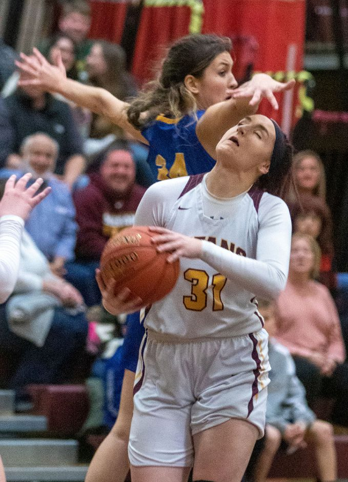 Sheehan's Hayleigh Lagase gets under Mercy's Samantha Strell hand as she makes a lay-up during the second half at Sheehan High School on Friday, February 14, 2020. Aaron Flaum, Record-Journal