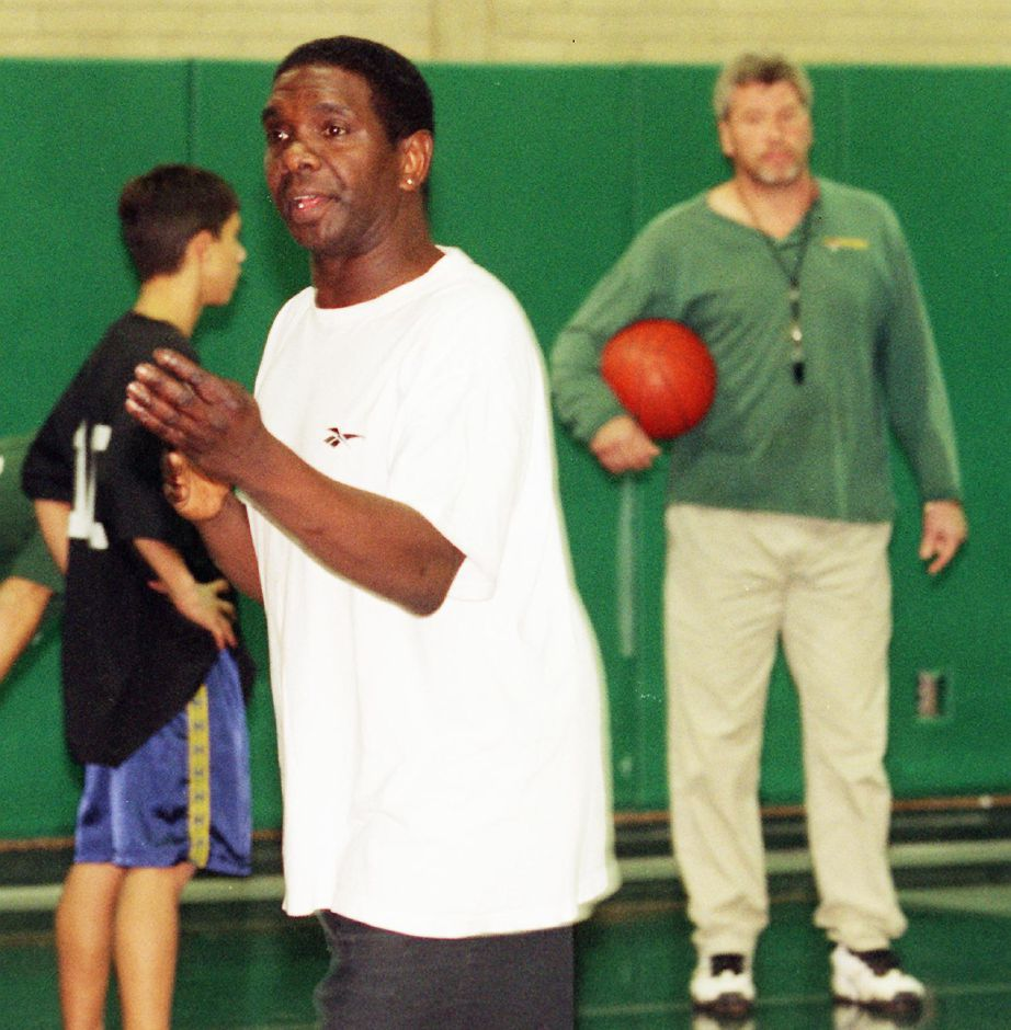 Sonny Williams, center, refs a Cuno League basketball game at the Boys Club in Meriden Wed., Oct. 20 1999 with John Curry, right.