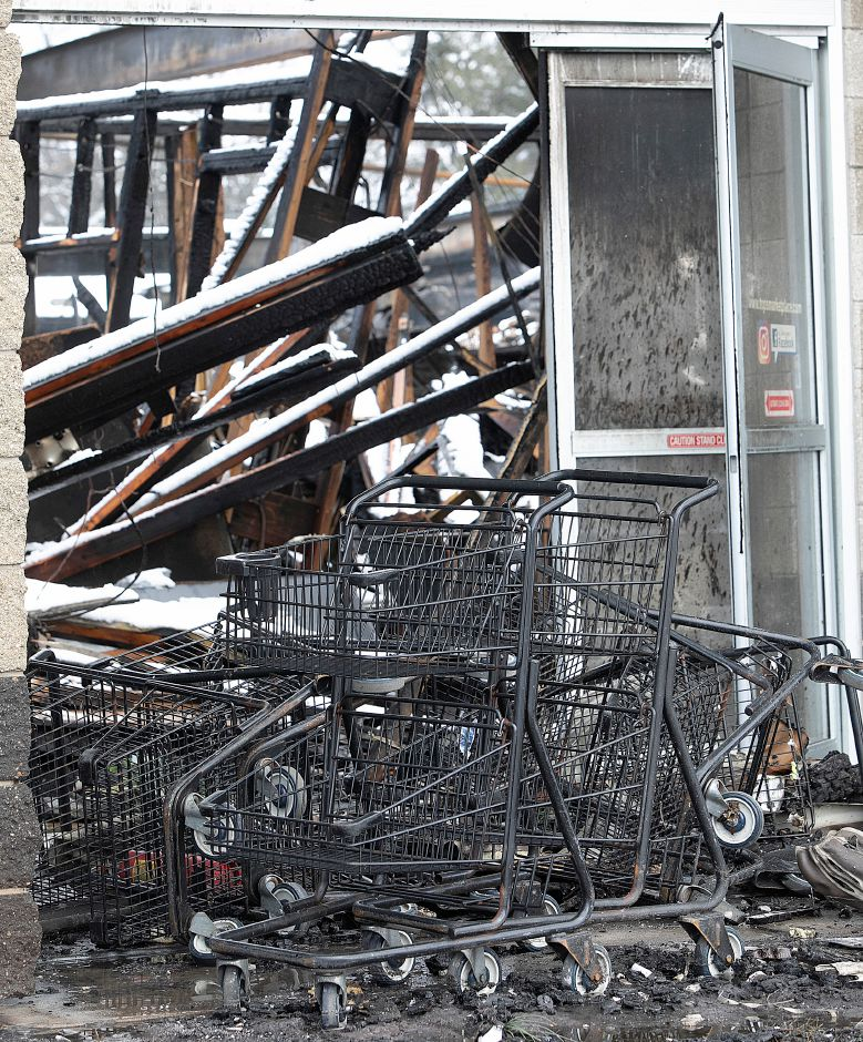Shopping carriages at the front entrance to Tops Marketplace, 887 Meriden-Waterbury Turnpike in Southington, Mon., Mar. 4, 2019. The business was destroyed by fire Sunday night. Dave Zajac, Record-Journal