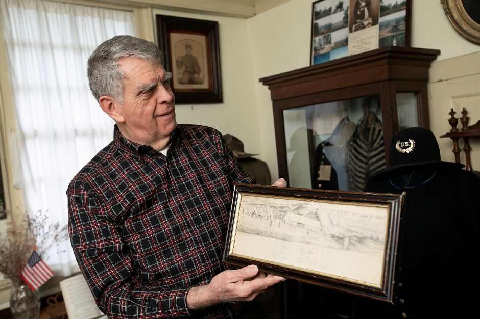 Wallingford Historical Society Vice President Bob Beaumont holds a drawing of the Hospital of the Independent Battalion New York Volunteers at the Wallingford Historical Society on Tuesday. Dave Zajac, Record-Journal