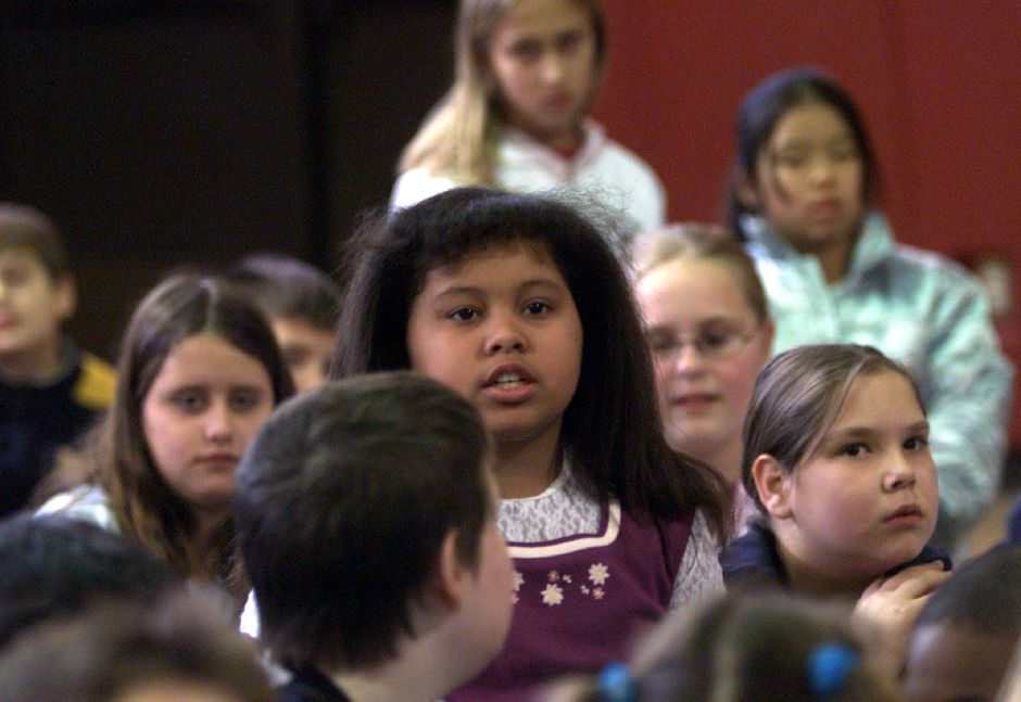 "Rebecca Salgodo, a fifth grader at Nathan Hale Elementary School in Meriden, asks a question during a presentation about the late Rev. Martin Luther King Jan. 3, 2001. ""Did the Puerto Rican people have the same problems?"""