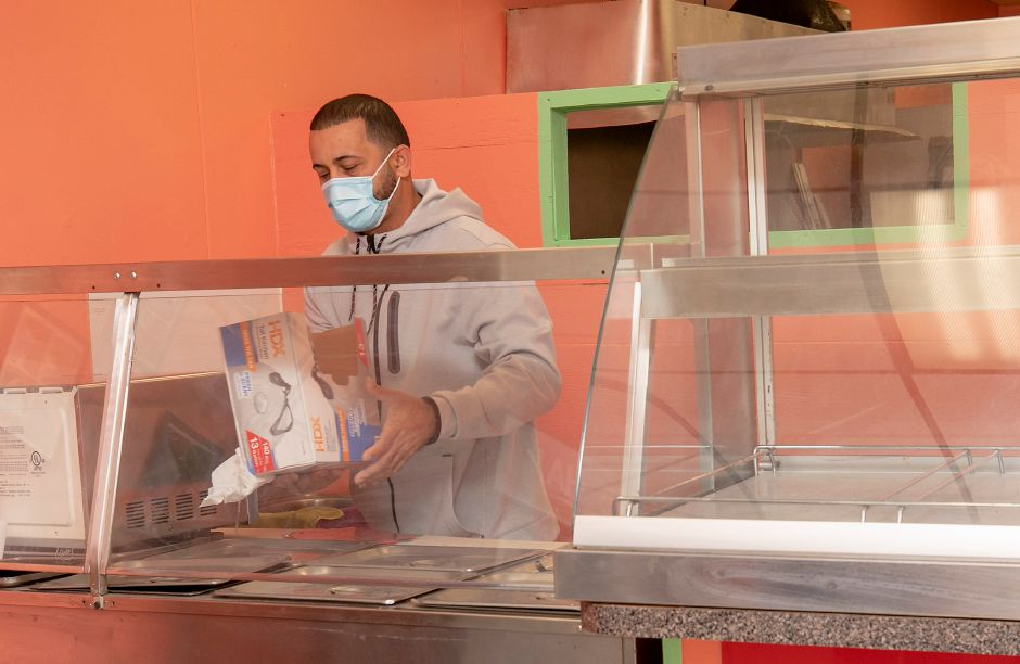 Wilfredo Ribot, co-owner of El Jibarito Take Out, is preparing the new restaurant for opening at 620 E. Main St., Meriden, Mon., Oct. 5, 2020. Dave Zajac, Record-Journal