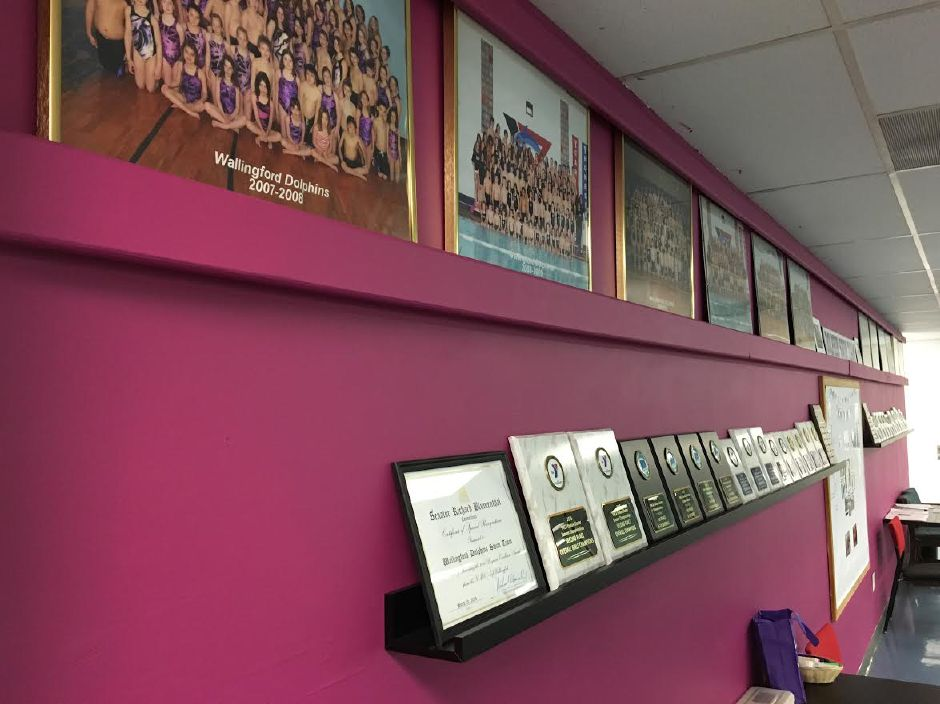 The observation deck of the Wallingford Family YMCA overlooking the lap swimming pool, displaying Dolphins swim team photos, awards and recognitions on July 31, 2019. | Courtesy of Eric Hutchinson