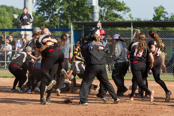 Cheshire players celebrate the school's first state softball championship Saturday after beating Amity 5-0 in the CIAC Class LL final at Frank Biondi Field in West Haven.