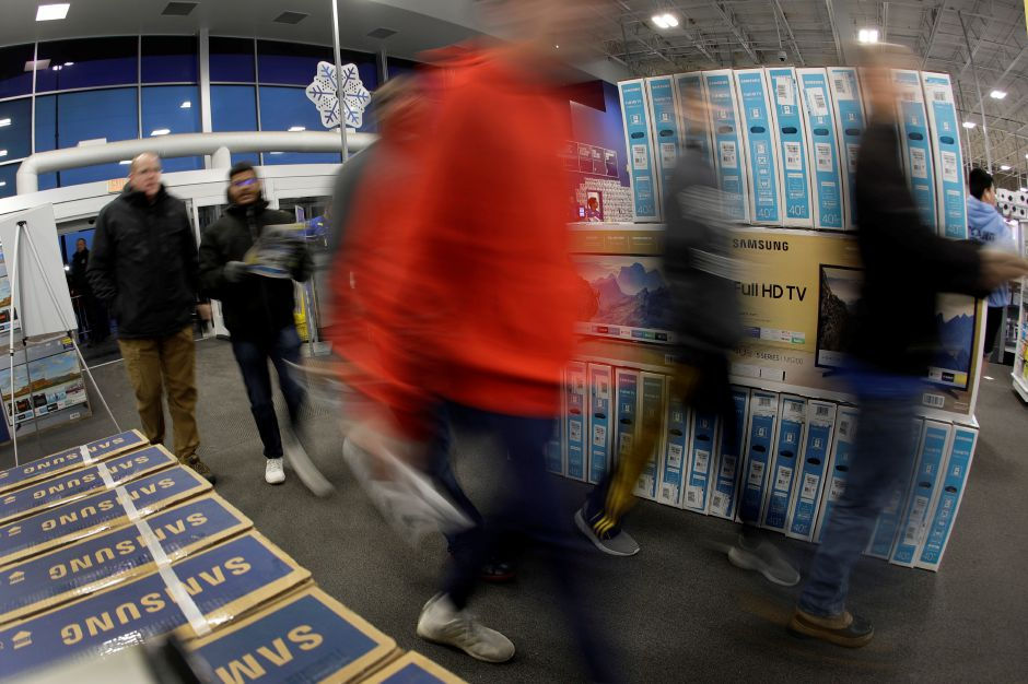 Shoppers enter a Best Buy store for a Black Friday sale Thursday, Nov. 28, 2019, in Overland Park, Kan. (AP Photo/Charlie Riedel)