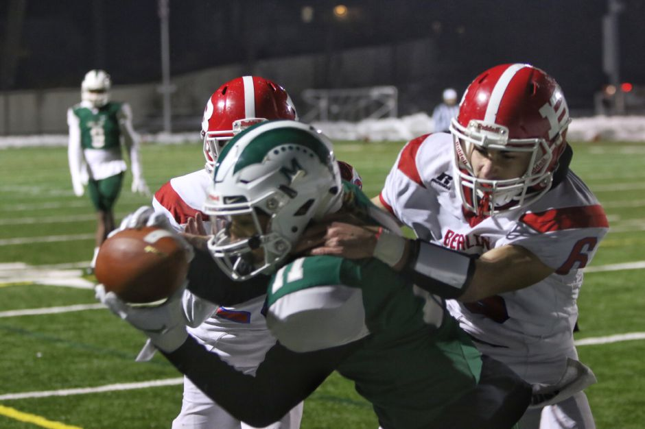 An 83-yard run by James Tarver set up one of Angel Arce's three first-half touchdown passes to Kam Moreno at Falcon Field. Maloney leads Berlin at the break, 21-7. | Aaron Flaum / Record-Journal