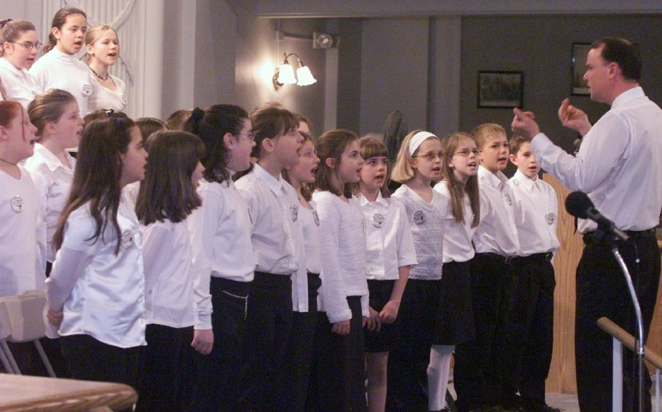 Peter Braunfield, right, directs the Yalesville Elementary School Chorus during Wallingford