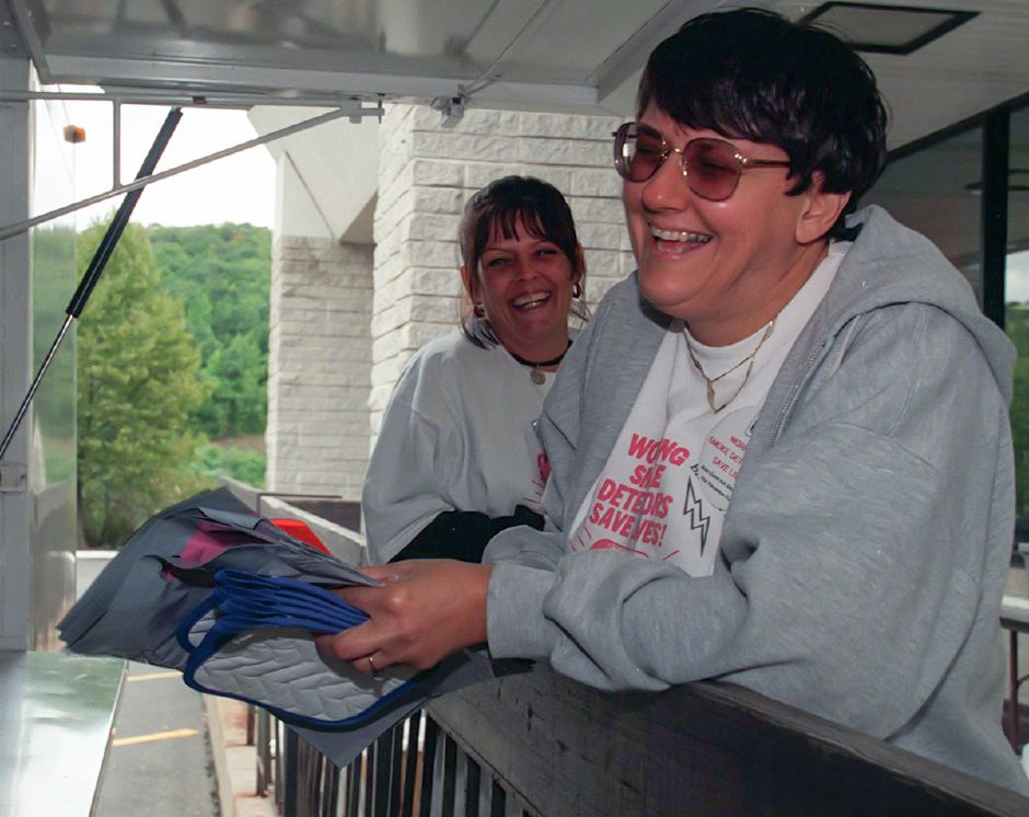 Roberta Ash and Donna Church, both of Meriden, share a laugh during the annual fundraiser for Brian David Ash at Super Food Mart in Meriden Sept. 17, 1999.