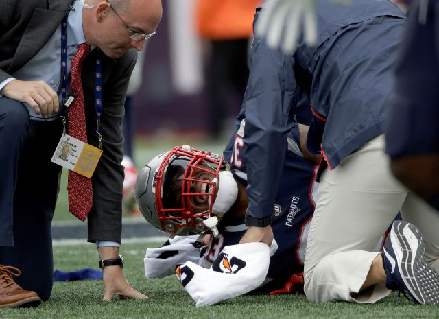 New England Patriots running back Jeremy Hill receives attention on the field after an injury during the second half of an NFL football game against the Houston Texans, Sunday, Sept. 9, 2018, in Foxborough, Mass. (AP Photo/Steven Senne)