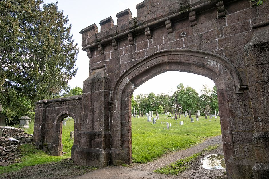 The entrance to East Cemetery in Meriden, Thurs., May 16, 2019. Many issues plague the cemetery including monument damage, missing rails, tall grass and an infestation of groundhogs. East Cemetery is located at the end of Miles Place off East Main Street. File photo. Dave Zajac, Record-Journal