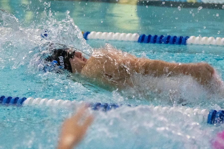 Southington's Tyler Heidgerd swims the backstroke leg of the 200 medley relay to kick off Friday's CCC dual meet against Middletown at Middletown High School. Heidgerd and his teammates won the race in 1:46.44 and, utlimately, the meet, 96-90. Aaron Flaum, Record-Journal