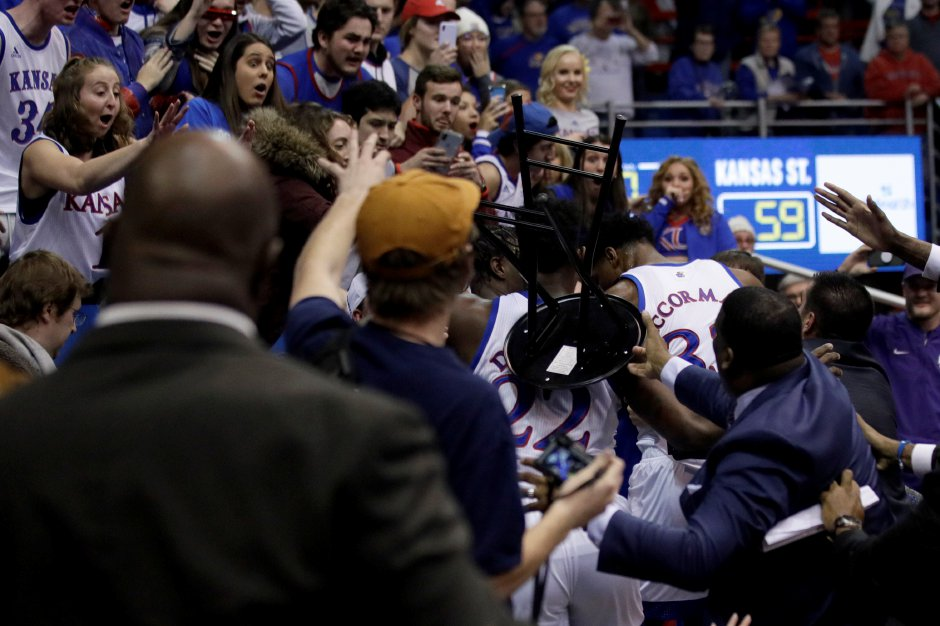 A fight between players spills into the crowd at the end of  Kansas' 81-60 win over Kansas State in Lawrence, Kansas, Tuesday night.  Orlin Wagner, Associated Press