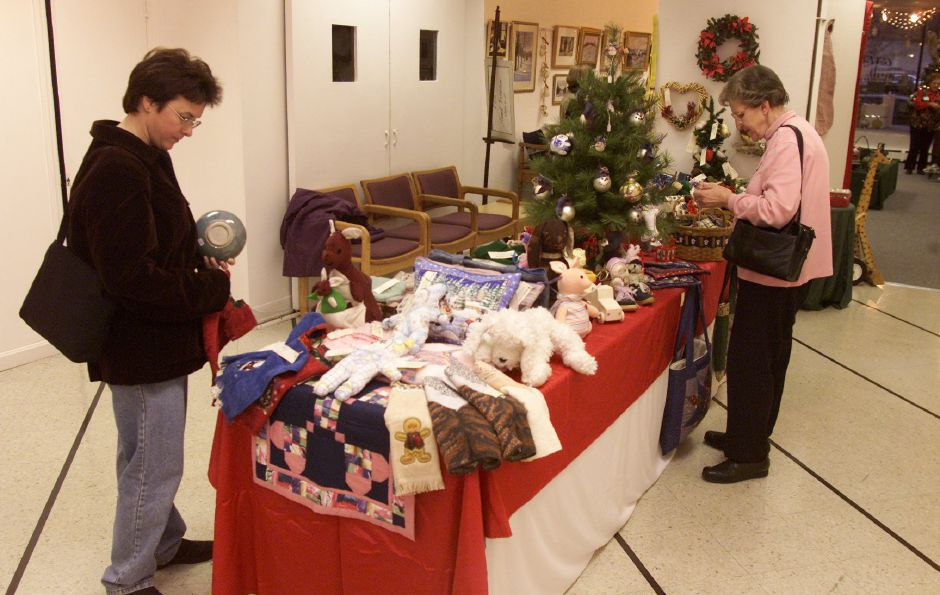 Shoppers check out some of the items for sale during a holiday fair at Gallery 53.